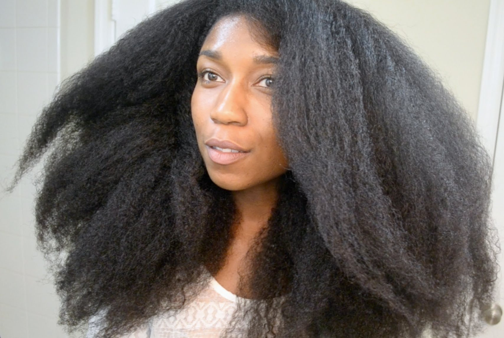 Whitney White with blow-out of current hair length, 2018.